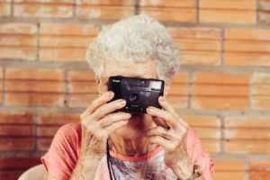 Image of a Senior holding a camera up